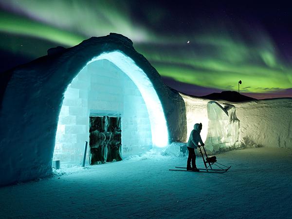 Woman on Kick Sled with Aurora Borealis, Ice Hotel